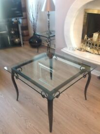 Glass top table with wrought iron legs