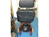 SHOPRIDER ELECTRIC WHEELCHAIR red folds flat max user weight 18 stone left or right hand lovely con.