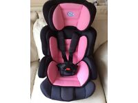 Child's adjustable car seat, pink. Groups 1 and 2.