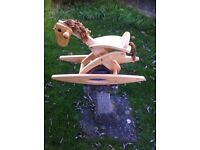 Nice small wooden rocking horse.