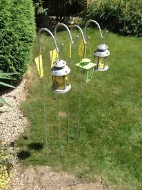 4x garden hooks and 3x garden lanterns