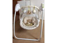 Baby swinging chair with music from Mothercare