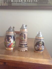 3 German lidded steins. One musical