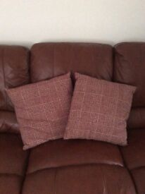Pair of red check cushions