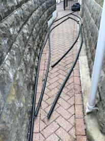 Outdoor ridged conduit and armoured cable.