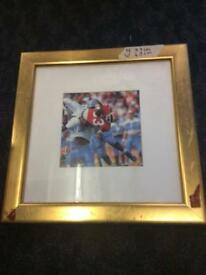 Selection of sports pictures framed