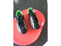 Size 2.5 adidas black and green mounded sole in good condition.