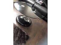 Black glass swivel contemporary coffee table