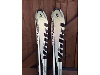 Volkl 320 Energy carving skis with motion bindings.