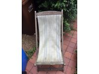 Vintage wooden deck chair with canvas fabric seat