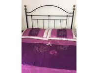 Double bedspread with matching pillow shams in purple