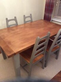 Solid oak dinning table and six chairs. With painted same colour pine dresser.