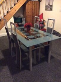 Glass top dining table with 4 matching chairs