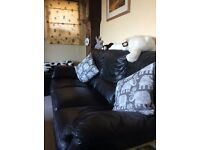 Three seater black leather sofa, very good condition