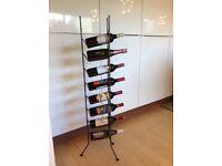 Metal wine rack, triangle shape, holds 8 bottles, 120cm high.