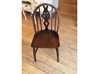 A SUPER LITTLE ERCOL CHAIR WITH GENUINE LABEL AND DECOR TO THE CENTRE BACK