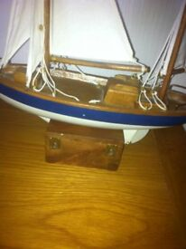 wooden model sailing boat and wooden lighthouse