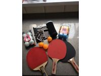 Table tennis set with bats, balls and net, table fixing.