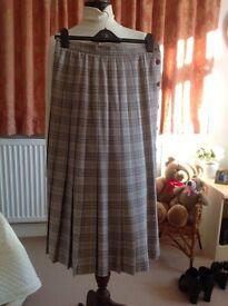 A pleated Aquascutum Skirt in Neutral Colours