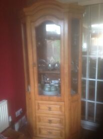 Tall style display cabinet.Two glass shelves three drawers.