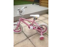 Pink girls bike for ages 2-6 from Argos.