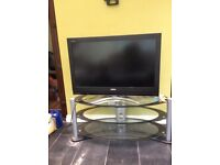 Television and glass table