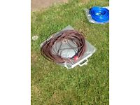 Whale water hose and TV cable
