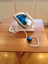 Cordless electric steam iron with docking station