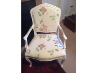 White chair with floral fabric