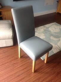 Four dining chairs. Light grey faux leather