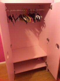 Child's pink wardrobe