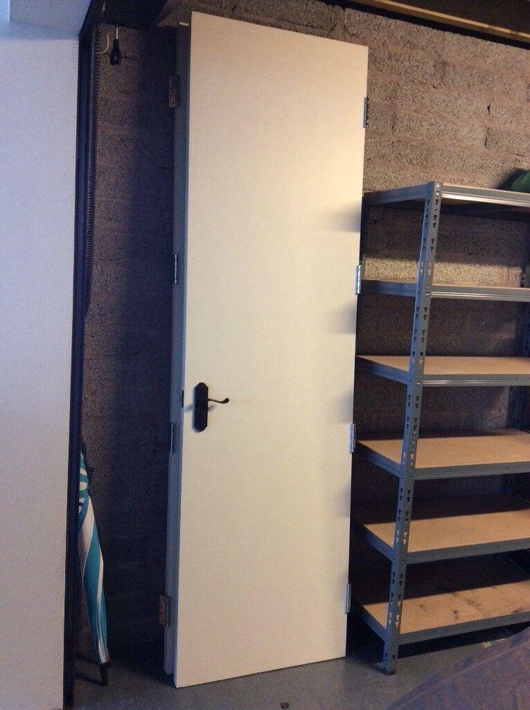 2 Tall Timber Flush Doors With Hinges Black Ironmongery