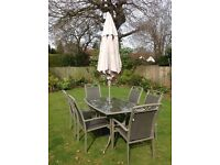 Leasure grow rectangular patio table and 6 arm chairs with parasol and base