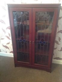 Display cabinet with stained glass doors