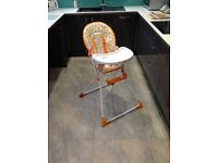 High chair new and boxed