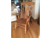A SUPER TRADITIONAL SOLID BEECH ROCKING CHAIR WITH FIDDLE DESIGN TO THE CENTRE BACK