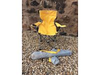 2 yellow folding camping chairs