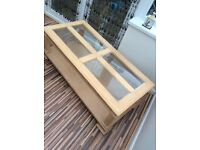 Solid wood coffee table with removeable glass panels