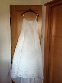 Wedding dress, Designer - Ronald Joyce, size 18 but small made. Already dry cleaned and immaculate