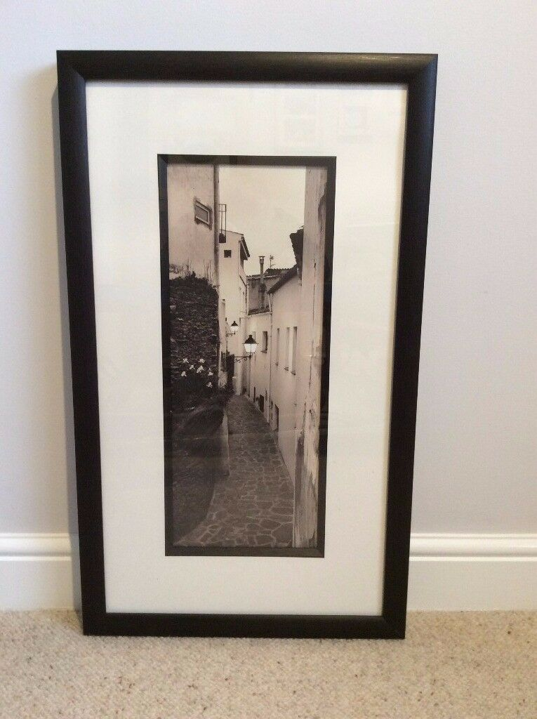 dark brown framed sepia coloured street view picture set on a good quality mount.