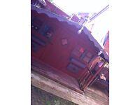 wooden playhouse with veranda