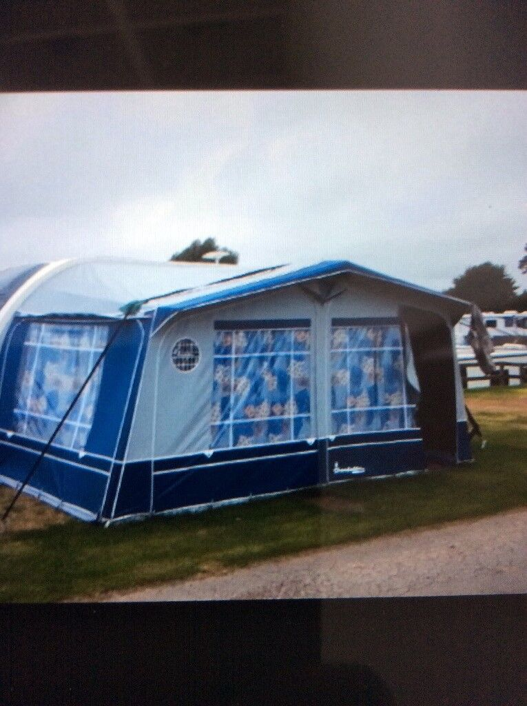 Isabella Capri Luxe Awning. 975cm in blue/grey. Fibreglass poles, curtains. Good condition