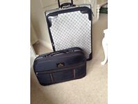 One large soft suitcase and smaller weekend case