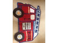 Next Fire Engine rug and pair of tab top curtains