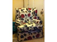 Comfortable, light weight re upholstered chair.
