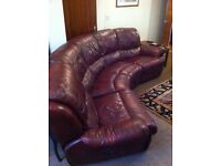 Curved double reclining sofa