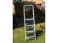 Heavy duty white step ladders.