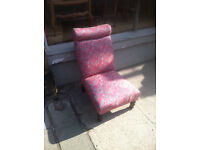 Low vintage chair , with head rest . On mahogany legs. Free local delivery.