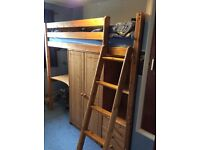 HIGHSLEEPER, SOLID PINE, WITH WARDROBE, 3 DRAWERS, DESK, AND 4 SHELVES.