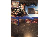PS4 500gb black plus 2 controllers, 5 games and gamers headset.